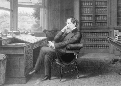 Pencil drawing of Charles Dickens sat at a desk