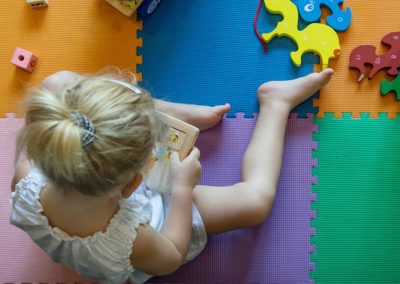 child playing with foam squares