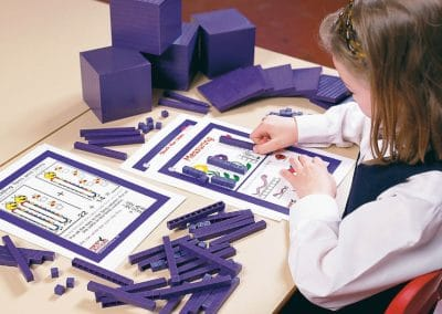 Young girl using manipulatives for maths mastery