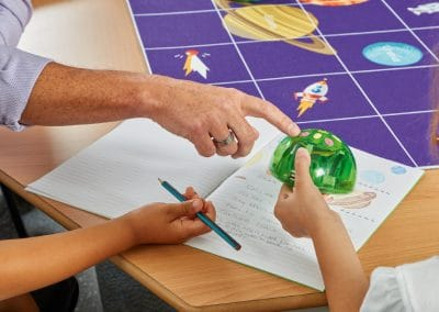 Teacher using Coding Robot to teach kids maths