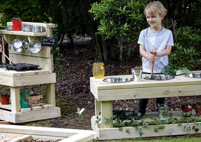 Child playing with mud kitchen