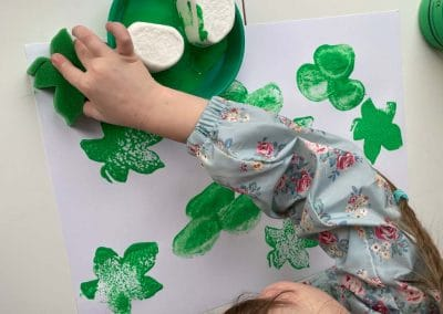 child doing st patricks day craft