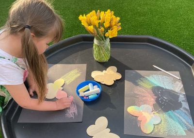 child making butterfly craft